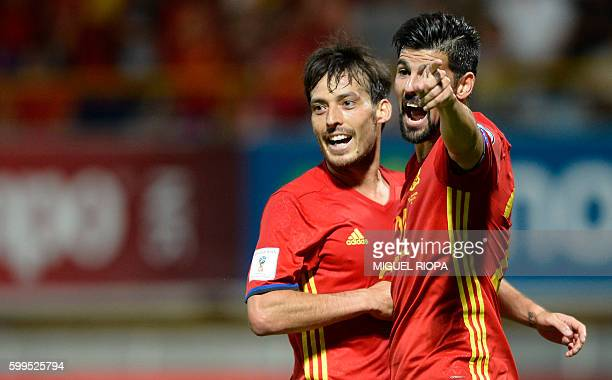 Spain's midfielder David Silva celebrates with teammate forward Nolito after scoring a goal during the WC 2018 football qualification match between...
