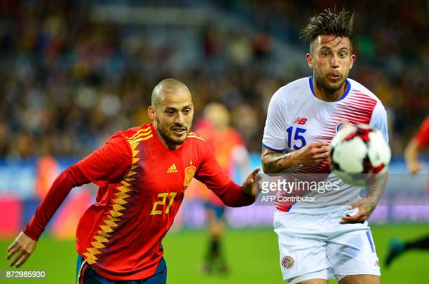 Spain's midfielder David Silva fights for the ball with the ball with Costa Rica's midfielder David Guzman during the international friendly football...