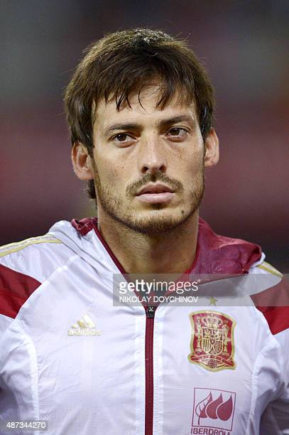 Spain's midfielder David Silva listens to the national anthem prior to the Euro 2016 Group C qualifying football match between Macedonia and Spain at...