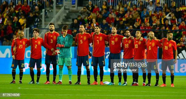 Spain's midfielder David Silva Spain's defender Dani Carvajal Spain's defender Gerard Pique Spain's goalkeeper Kepa Arrizabalaga Spain's midfielder...