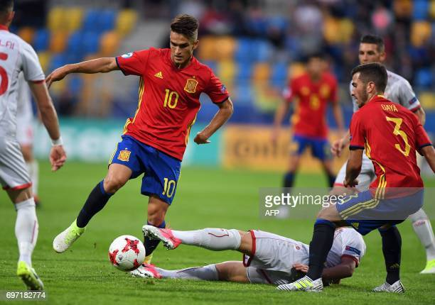 Spain's midfielder Denis Suarez vies the ball with Macedonian players during the group stage Group B match Spain vs FYR Macedonia of the 2017 UEFA...