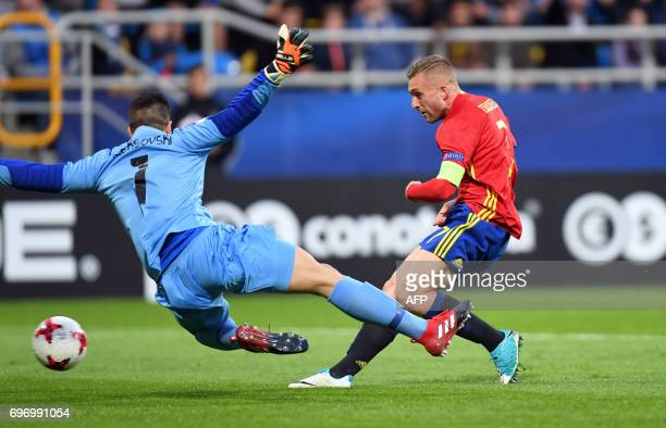 Spain's midfielder Gerard Deulofeu fails to score past Macedonia's goalkeeper Igor Aleksovski during the UEFA U21 European Championship Group B...