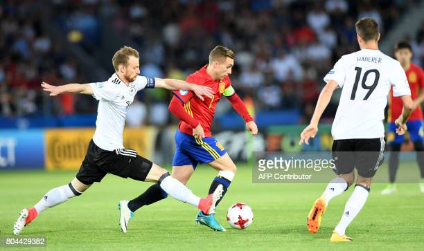 Spain's midfielder Gerard Deulofeu vies for the ball with Germany's forward Janik Haberer during the UEFA U21 European Championship football final...