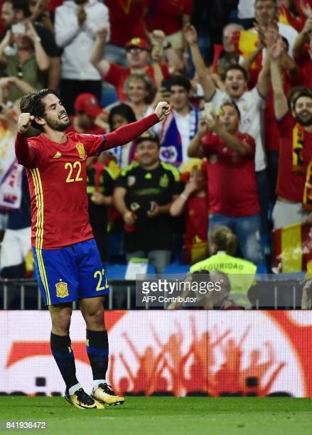 Spain's midfielder Isco celebrates a goal during the World Cup 2018 qualifier football match between Spain and Italy at the Santiago Bernabeu stadium...