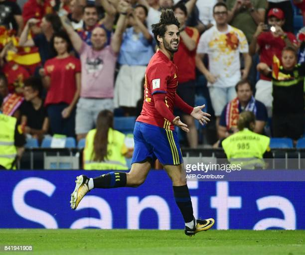 Spain's midfielder Isco celebrates his second goal during the World Cup 2018 qualifier football match between Spain and Italy at the Santiago...