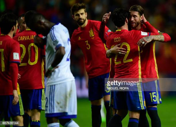 Spain's midfielder Isco celebrates with teammate defender Sergio Ramos after scoring a goal during the WC 2018 group G football qualifing match Spain...