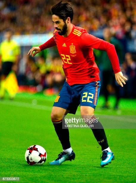 Spain's midfielder Isco controls the ball during the international friendly football match Spain against Costa Rica at La Rosaleda stadium in Malaga...