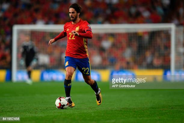 Spain's midfielder Isco drives the ball during the World Cup 2018 qualifier football match Spain vs Italy at the Santiago Bernabeu stadium in Madrid...
