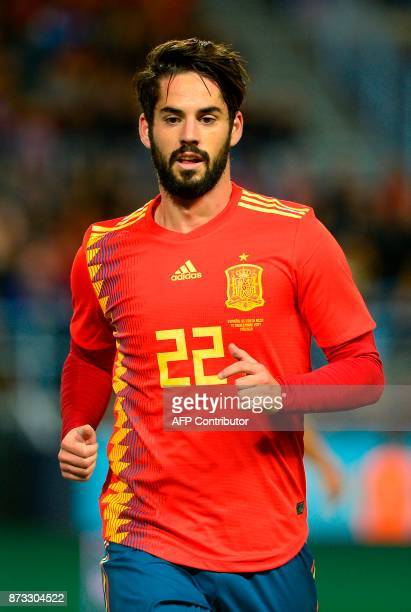 Spain's midfielder Isco runs during the international friendly football match Spain against Costa Rica at La Rosaleda stadium in Malaga on November...