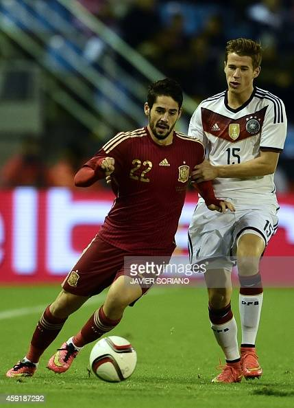 Spain's midfielder Isco vies with Germany's defender Erik Durm during a friendly football match Spain vs Germany at the Balaidos stadium in Vigo on...