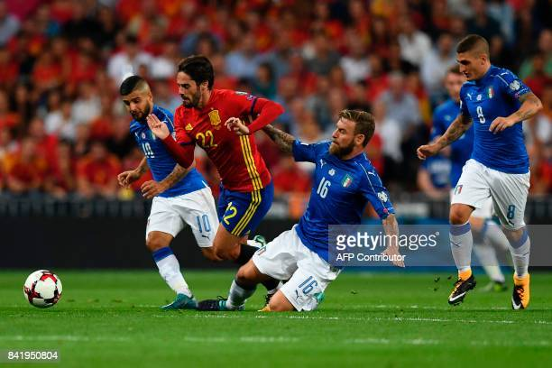 Spain's midfielder Isco vies with Italy's forward Lorenzo Insigne and Italy's midfielder Daniele De Rossi and Italy's midfielder Marco Verratti...
