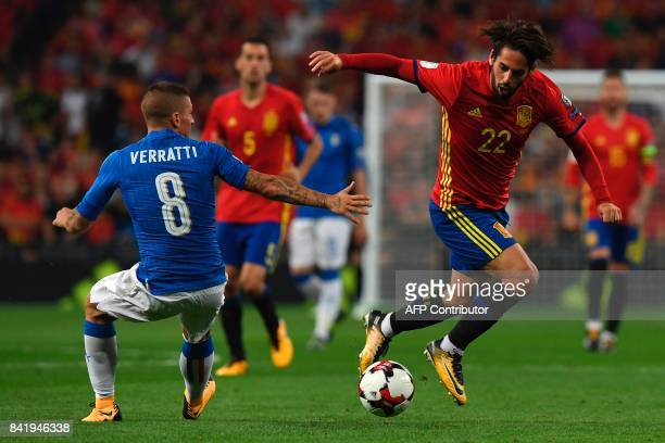 Spain's midfielder Isco vies with Italy's midfielder Marco Verratti during the World Cup 2018 qualifier football match Spain vs Italy at the Santiago...