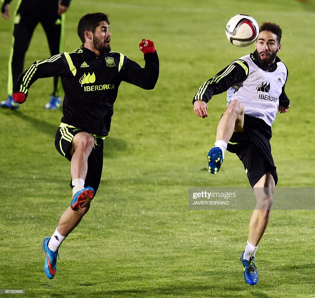 Spain's midfielder <a gi-track='captionPersonalityLinkClicked' href=/galleries/search?phrase=Isco&family=editorial&specificpeople=5848609 ng-click='$event.stopPropagation()'>Isco</a> (L) vies with Spain's defender Daniel Carvajal during a training session at the Sport City training ground in Las Rozas, near Madrid on March 25, 2015, ahead of the EURO 2016 qualifiers football match against Ukraine.