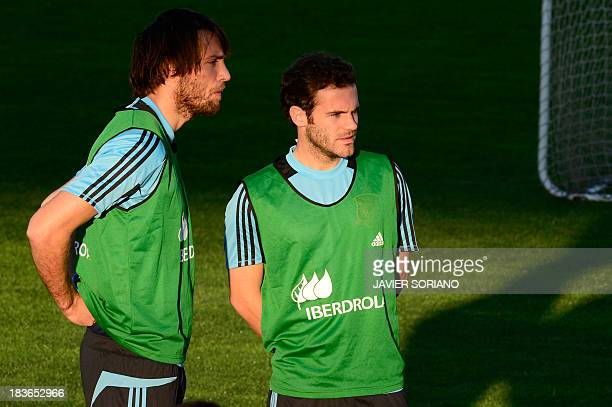 Spain's midfielder Juan Mata and Spain's forward Michu attend a training session at Las Rozas Sport City near Madrid on October 8 ahead of their FIFA...