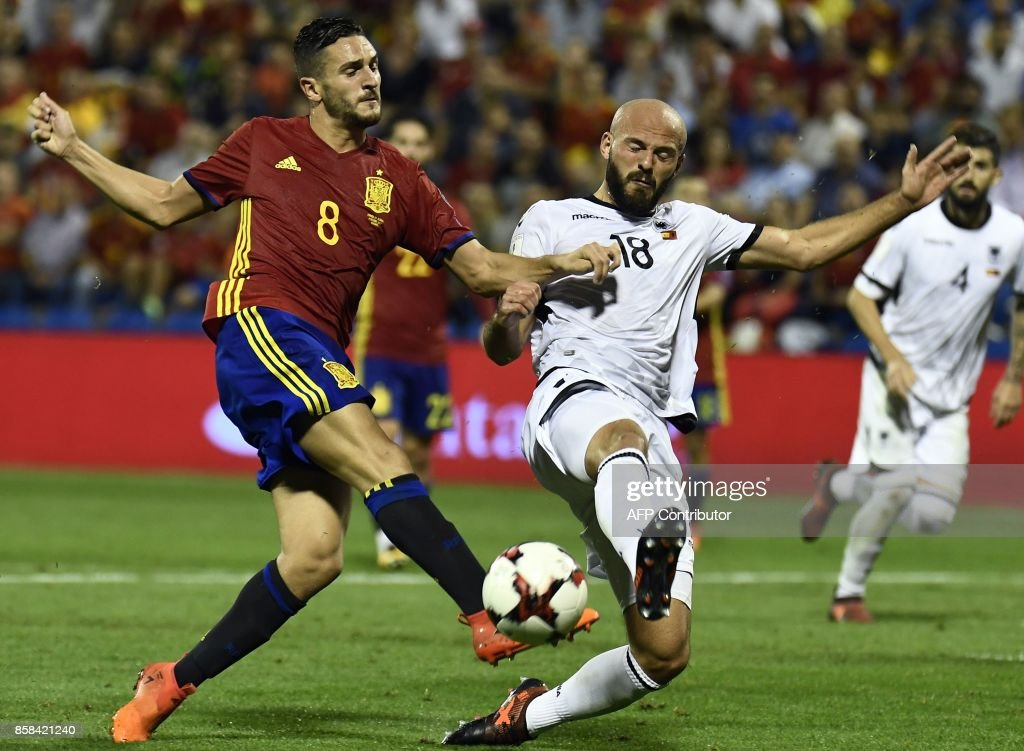 Spain's midfielder Koke (L) vies with Albania's defender Arlind Ajeti during the World Cup 2018 qualifier football match Spain vs Albania at the Jose Rico Perez stadium in Alicante on October 6, 2017. /