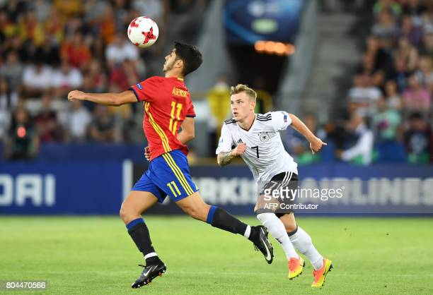Spain's midfielder Marco Asensio and Germany's midfielder Max Meyer vie for the ball during the UEFA U21 European Championship football final match...
