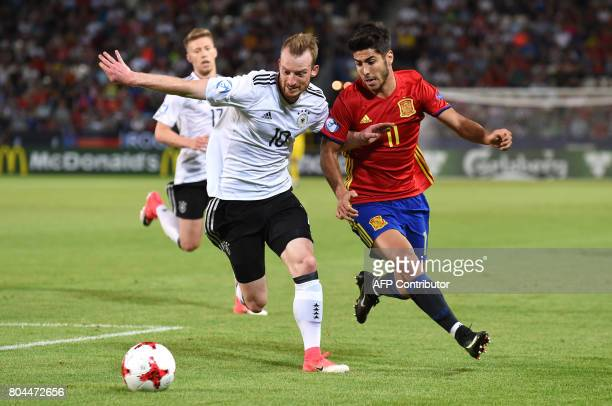 Spain's midfielder Marco Asensio and Germany's midfielder Maximilian Arnold vie for the ball during the UEFA U21 European Championship football final...