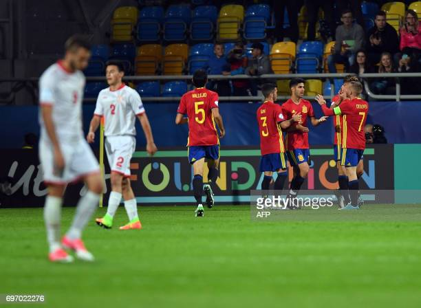 Spain's midfielder Marco Asensio celebrates scoring with his teammates during the UEFA U21 European Championship Group B football match Spain v FYR...