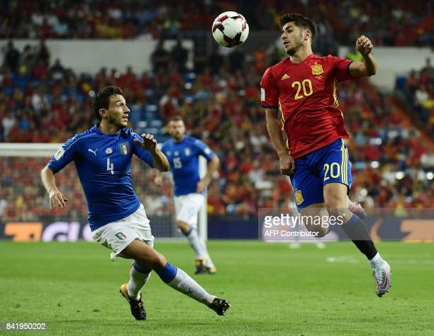 Spain's midfielder Marco Asensio vies with Italy's midfielder Matteo Darmian during the World Cup 2018 qualifier football match between Spain and...