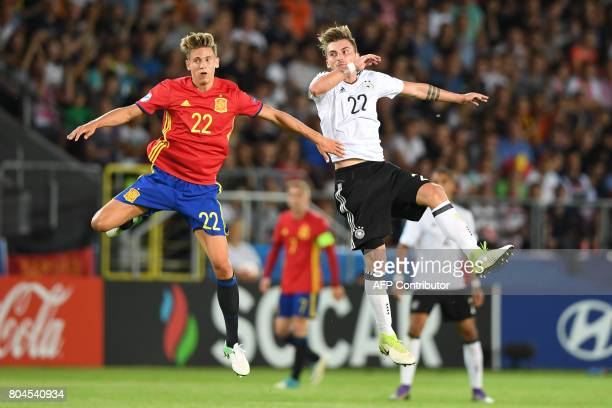 Spain's midfielder Marcos Llorente and Germany's forward Maximilian Philipp vie for the ball during the UEFA U21 European Championship football final...