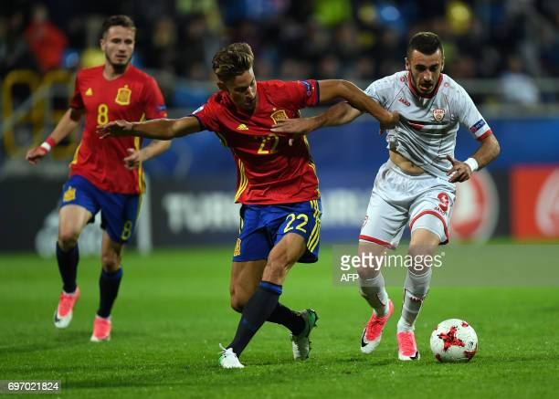 Spain's midfielder Marcos Llorente and Macedonia's forward Marjan Radeski vie for the ball during the UEFA U21 European Championship Group B football...