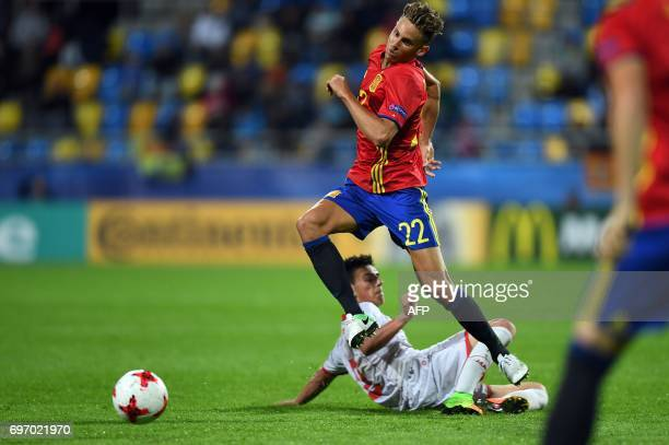 Spain's midfielder Marcos Llorente and Macedonia's midfielder Enis Bardi vie for the ball during the UEFA U21 European Championship Group B football...