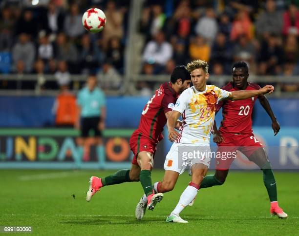 Spain's midfielder Marcos Llorente Moreno and Portugal's midfielder Bruma vie during the UEFA U21 European Championship Group B football match Spain...