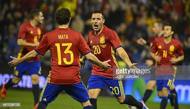 Spain's midfielder Santi Cazorla celebrates with a teammate after scoring during the friendly football match Spain vs England at the Jose Rico Perez...