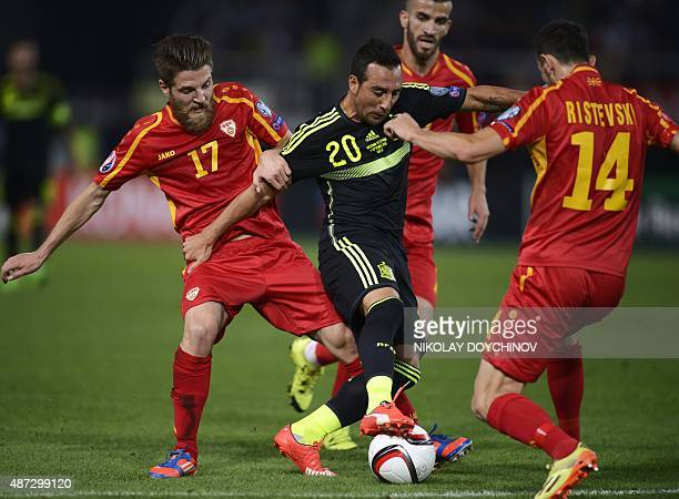 Spain's Midfielder Santi Cazorla vies with Macedonia's Defender Kire Ristevski during the Euro 2016 Group C qualifying football match between...