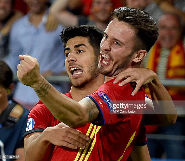CORRECTION Spain's midfielder Saul Niguez and Andrea Petagna reacts after he scored a goal during the UEFA U21 European Championship football semi...