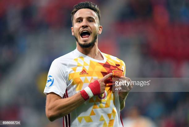 Spain's midfielder Saul Niguez celebrates scoring the opening goal during the UEFA U21 European Championship Group B football match Portugal v Spain...