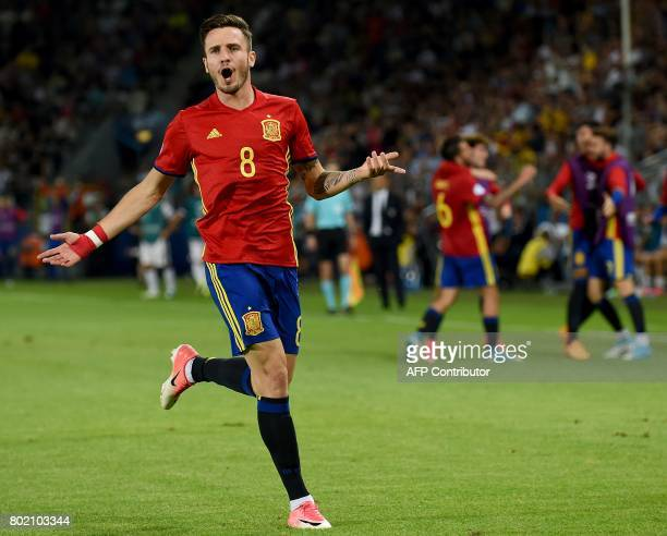 CORRECTION Spain's midfielder Saul Niguez reacts after he scored a second goal during the UEFA U21 European Championship football semi final match...