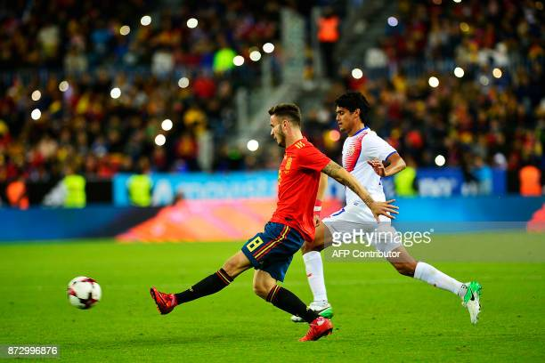 Spain's midfielder Saul vies with Costa Rica's midfielder Christian Bolanos during the international friendly football match Spain against Costa Rica...