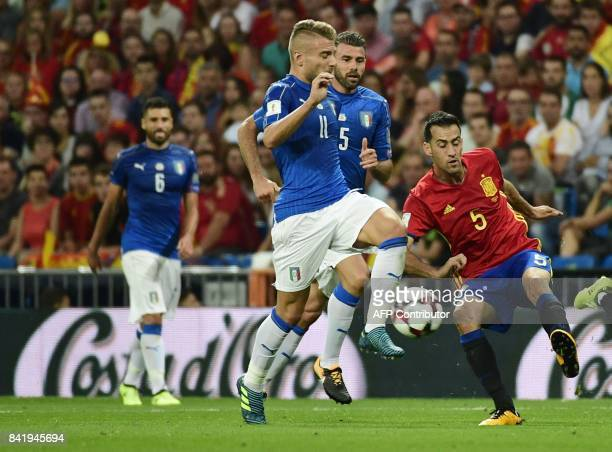 Spain's midfielder Sergio Busquets vies with Italy's defender Daniele Rugani and Italy's forward Ciro Immobile during the World Cup 2018 qualifier...