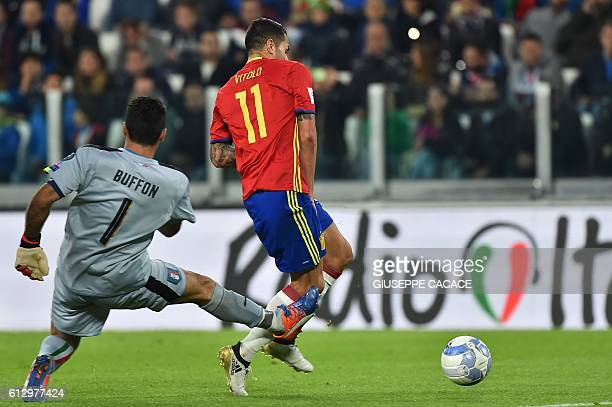 Spain's midfielder Vitolo passes Italy's goalkeeper Gianluigi Buffon and scores during the WC 2018 football qualification match between Italy and...