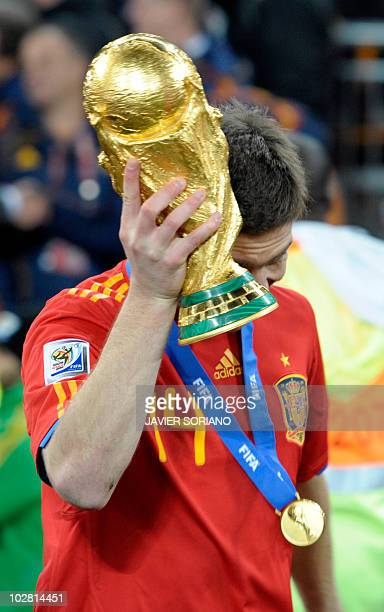 Spain's midfielder Xabi Alonso raises the trophy as he celebrates winning the 2010 World Cup football final Netherlands vs Spain on July 11 2010 at...