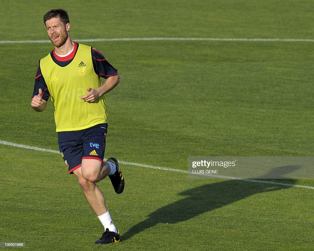 Spain's midfielder Xabi Alonso takes part in a training session of the Spanish football team with Spain's Prince Felipe on May 24, 2010, at the Sports City of Las Rozas, near Madrid. Spain, among the favourites for the World Cup, which runs from June 11-July 11, face Switzerland, Honduras and Chile in Group H of the opening round.