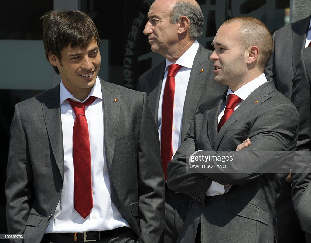 Spain's midfielders David Silva (L) and Andres Iniesta (R) chat before taking a group picture during the inauguration of Spanish Football Team museum on May 24, 2010 at the Sports City of Las Rozas, near Madrid. Spain, among the favourites for the World Cup, which runs from June 11-July 11, face Switzerland, Honduras and Chile in Group H of the opening round.
