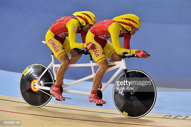 Spain's Miguel Angel Clemente Solano and Diego Javier Munoz compete in the men's individual B pursuit qualifying cycling event during the London 2012...