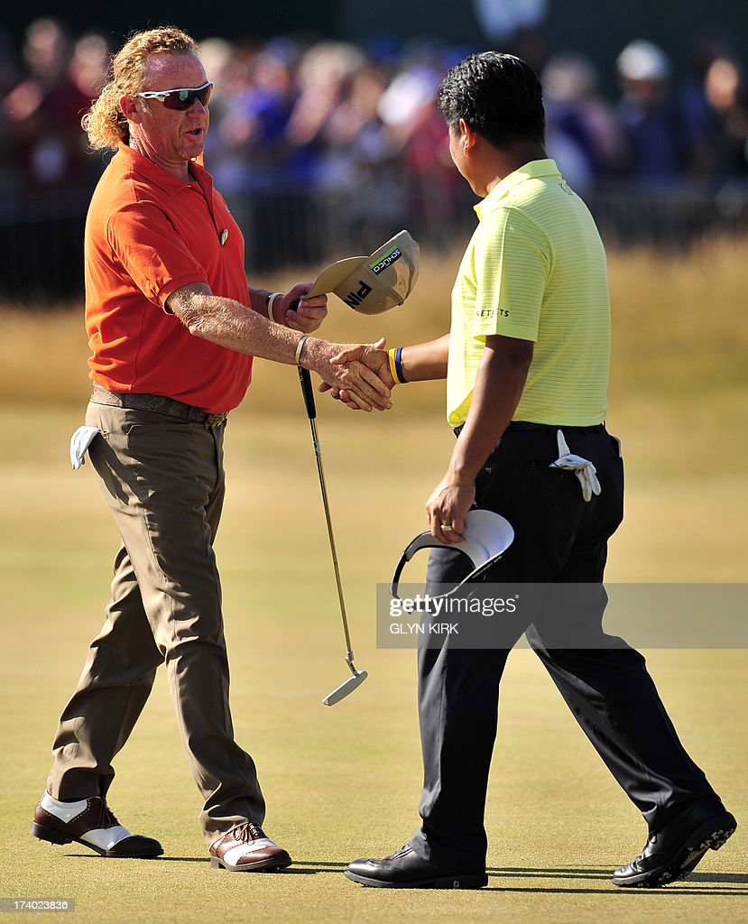 Spain's Miguel Angel Jimenez (L) and South Korea's Choi Kyung-Ju (AKA KJ Choi) shake hands after finishing their round on the18th green during the second day of the 2013 British Open Golf Championship at Muirfield golf course at Gullane in Scotland on July 19, 2013 .