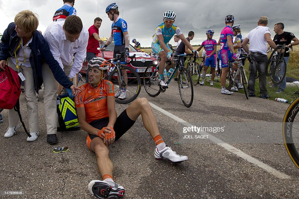 Spain's Mikel Astarloza grimaces after the crash of around 30 riders 26 km before the end of the 2075 km and sixth stage of the 2012 Tour de France...