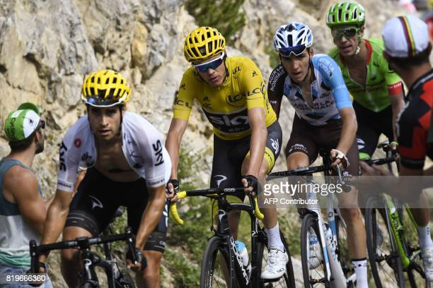 Spain's Mikel Landa Great Britain's Christopher Froome wearing the overall leader's yellow jersey France's Romain Bardet and Colombia's Rigoberto...