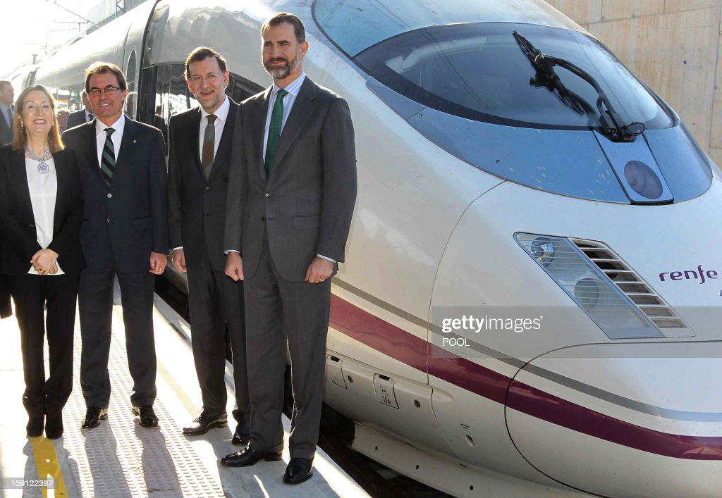Spain's Minister of Development Ana Pastor, President of the Catalonia regional government and leader of the Catalan party CIU (Convergence and Unity party) Artur Mas, Spanish Prime Minister and PP (Popular Party) leader Mariano Rajoy and Spain's Prince Felipe pose prior to onboard a train at Figueras, northeastern Spain during the inauguration of the high-speed line between Barcelona and the french border, on January 8, 2013.