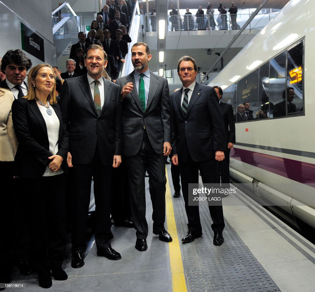 Spain's Minister of Development Ana Pastor, Spanish Prime Minister and PP (Popular Party) leader Mariano Rajoy, Spain's Prince Felipe, president of the Catalonia regional government and leader of the Catalan party CIU (Convergence and Unity party) Artur Mas in the Girona station prior to onboard a train back to Sants, Barcelona's train station, during the inauguration of the high-speed line between Barcelona and the french border, on January 8, 2013.