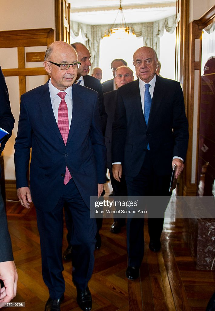 Spain's Minister of Treasury and Civil Services Cristobal Montoro Romero and President of Spanish bank BBVA Francisco Gonzalez attend at the...