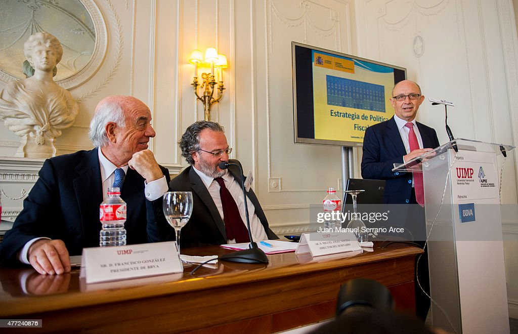 Spain's Minister of Treasury and Civil Services Cristobal Montoro Romero and President of Spanish bank BBVA Francisco Gonzalez speaks during a press...