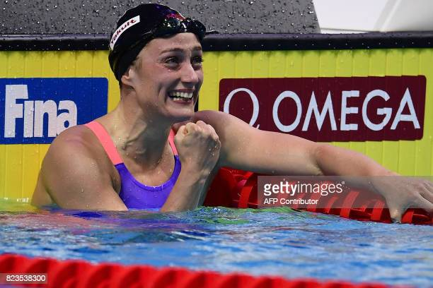 Spain's Mireia Belmonte celebrates after winning the women's 200m butterfly final during the swimming competition at the 2017 FINA World...