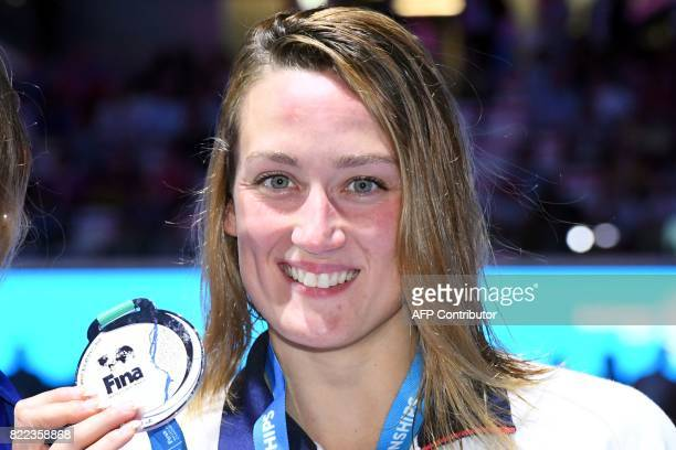 Spain's Mireia Belmonte celebrates on the podium after the women's 1500m freestyle final during the swimming competition at the 2017 FINA World...