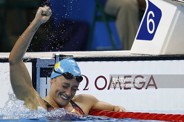 TOPSHOT Spain's Mireia Belmonte Garcia celebrates after she won the Women's 200m Butterfly Final during the swimming event at the Rio 2016 Olympic...