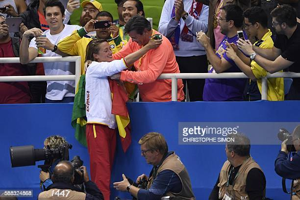 TOPSHOT Spain's Mireia Belmonte Garcia is congratulated by her father during the medal ceremony after she won the Women's 200m Butterfly Final during...
